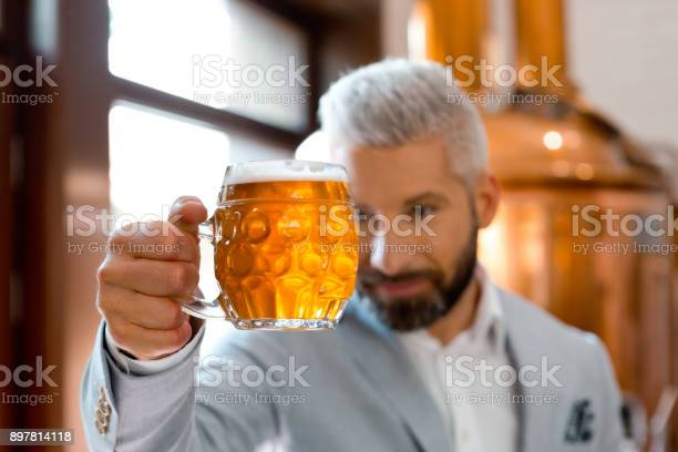 Microbrewery Owner Checking Quality Of Beer Stock Photo - Download Image Now