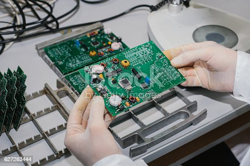 istock Microchip production factory. Technological process. Assembling the board. Computer expert. 627263444