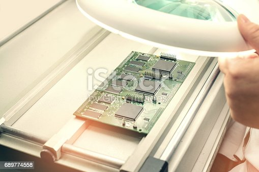 istock Microchip production factory. Technological process. Assembling the board. Chip. Professional. Technician. Computer expert. Manufacturing. Engineering. 689774558