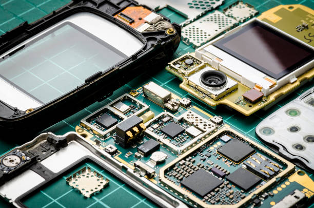 Microchips, semiconductor components and precious metals on the Board of the disassembled old mobile phone