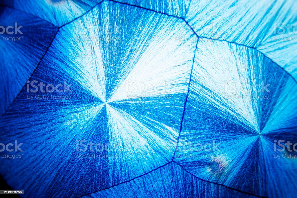 Microcrystals of ascorbic acid in polarized light stock photo