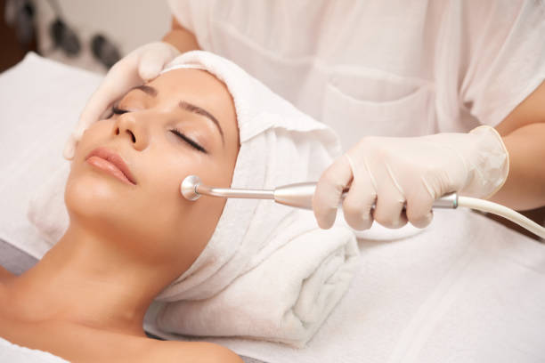 Microdermabrasion Cosmetologist using microdermabrasion machine for peeling, view from above oxygen stock pictures, royalty-free photos & images