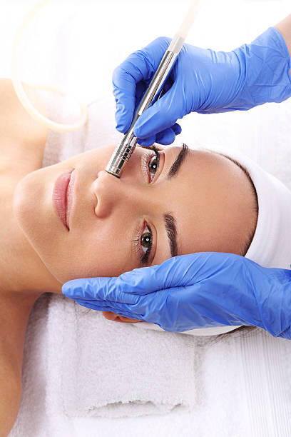Microdermabrasion Relaxed woman during a microdermabrasion treatment in beauty salon aha stock pictures, royalty-free photos & images