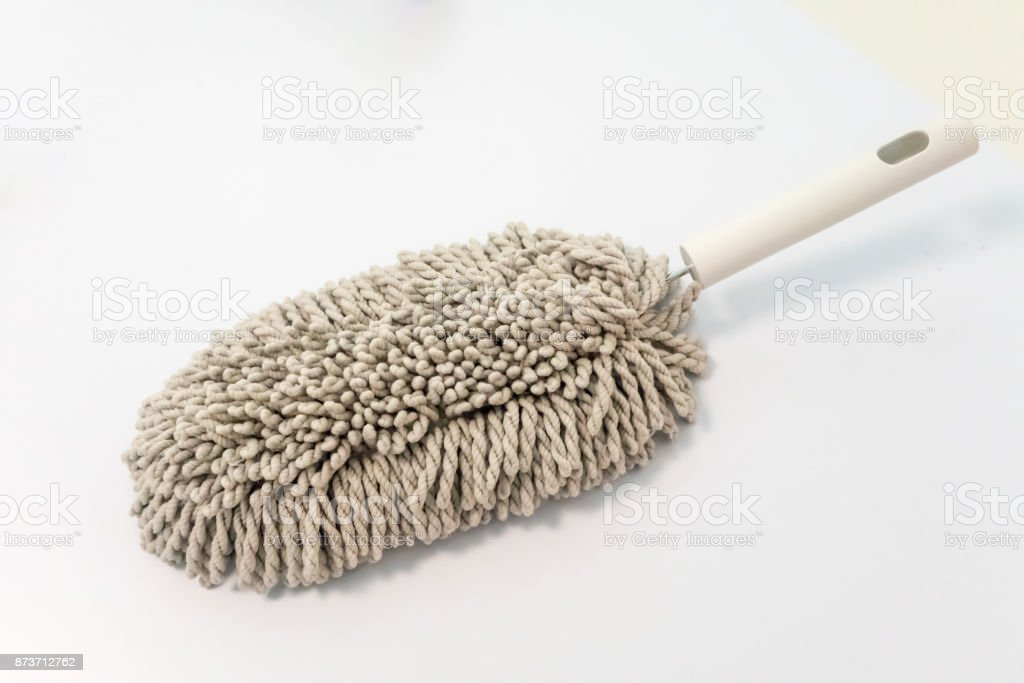 Microfiber brush duster with white handle for cleaning isolated on white background. stock photo