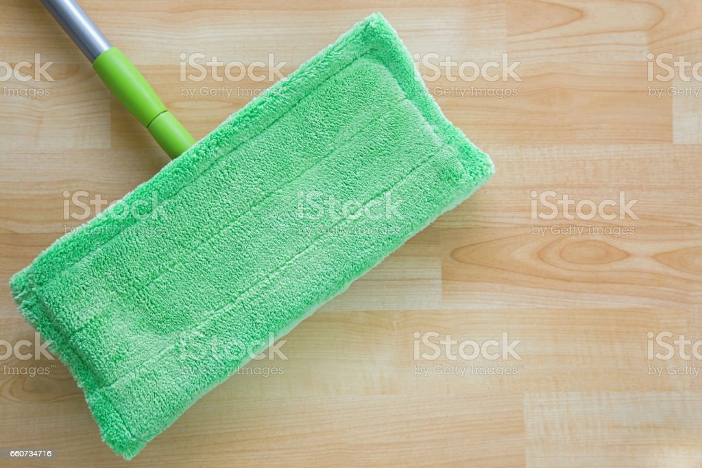 Microfiber mop floor wiper cleaning sweeping tool with silver handle on wooden floor stock photo