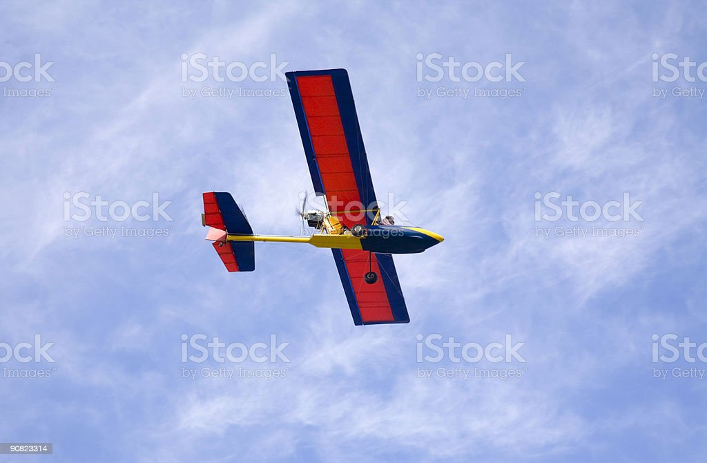 Microlight or Ultralight Aircraft in Blue Sky royalty-free stock photo
