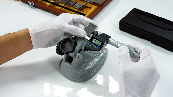 istock Micrometer Calibration with gauge block in Calibration laboratory 894147082
