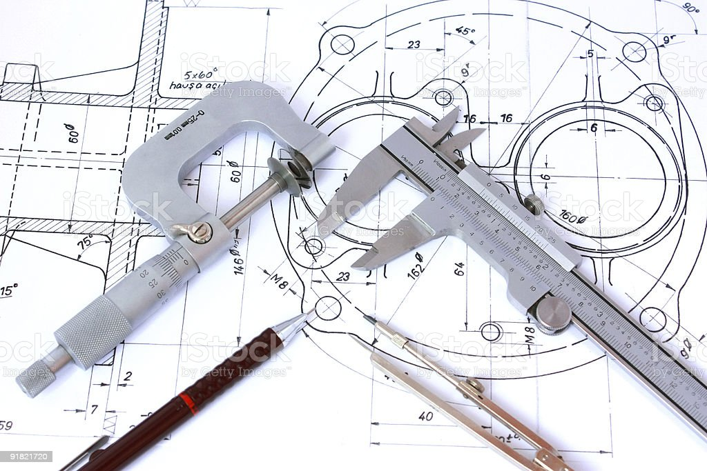 Micrometer, Caliper, Mechanical Pencil and Compass on  Blueprint royalty-free stock photo
