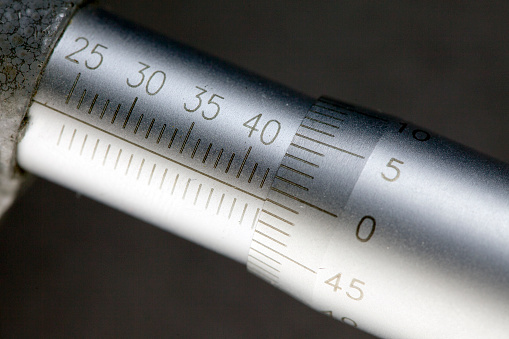 istock Micrometer, measuring scale close-up 1034485230
