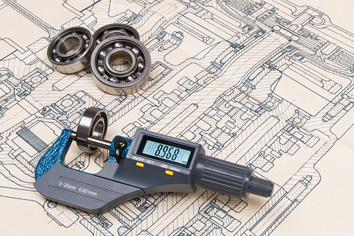 istock Micrometer screw gauge. Ball bearings. Drrafting. Technical drawing on background 1142679590