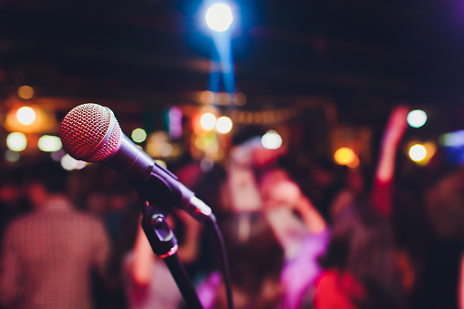 istock microphone against blur on beverage in pub and restaurant background. 1141693167