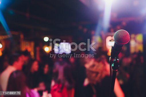 istock microphone against blur on beverage in pub and restaurant background. 1141693170