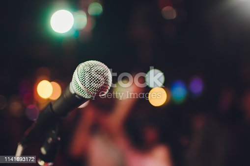 istock microphone against blur on beverage in pub and restaurant background. 1141693172