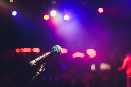 istock microphone against blur on beverage in pub and restaurant background. 1141790151