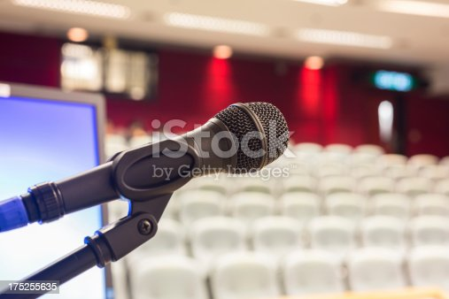 508658652istockphoto Microphone and Computer Screen in Modern Lecture Hall 175255635