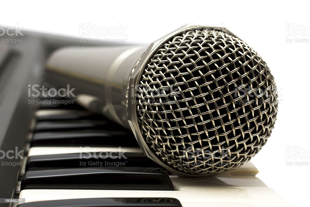 Microphone and electronic keyboard isolated on a white background royalty-free stock photo
