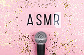 istock A microphone and letters ASMR on pink background. Minimal compostion. 1254221460