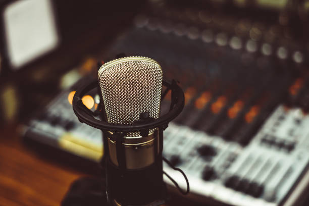 microphone and mixing console - radio dj stock photos and pictures