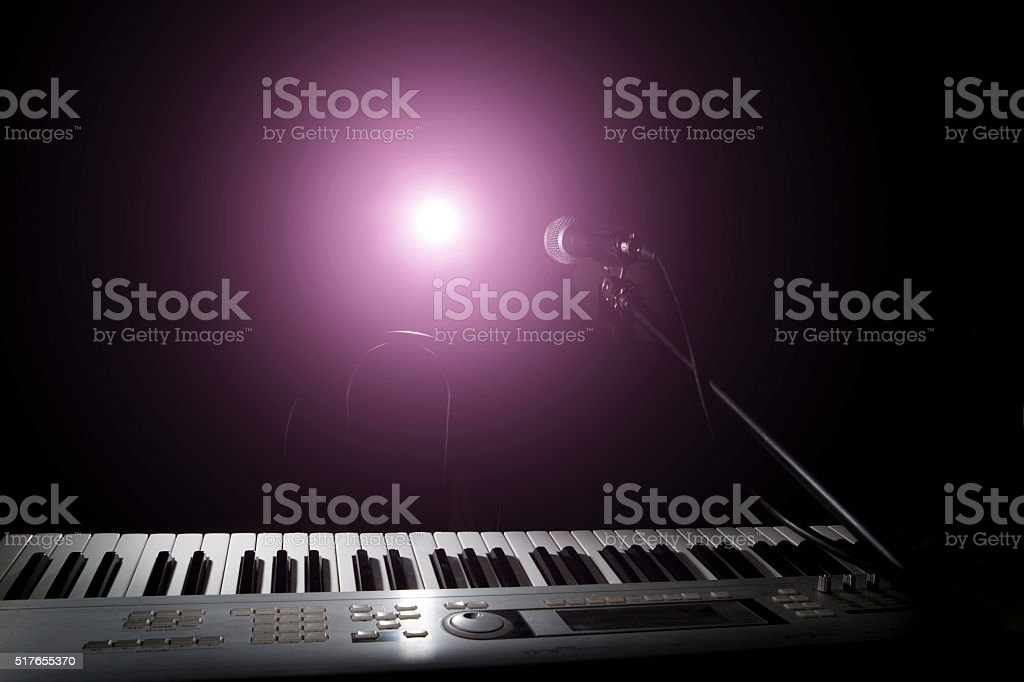Microphone  and piano in dark background stock photo