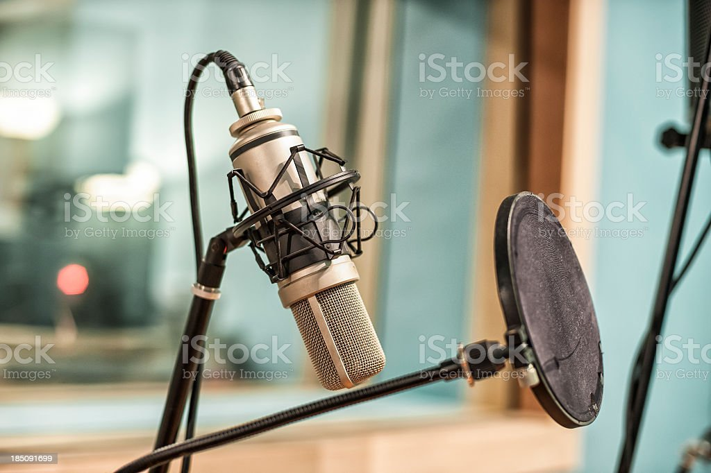 Microphone And Pop Filter In Recording Studio stock photo