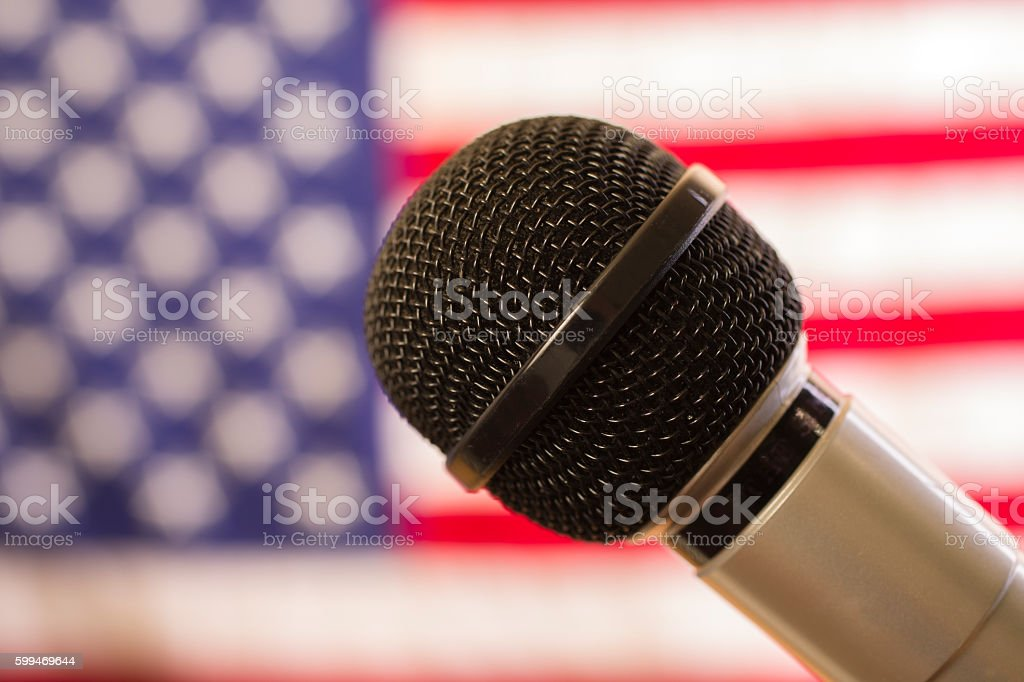 Microphone and USA flag at local political rally. stock photo