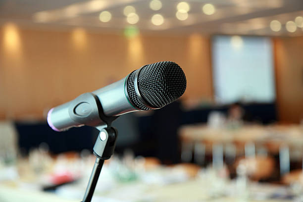 microphone at a lecture hall stock photo