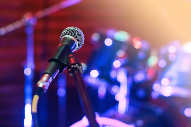 microphone at concert - arts culture and entertainment stock pictures, royalty-free photos & images