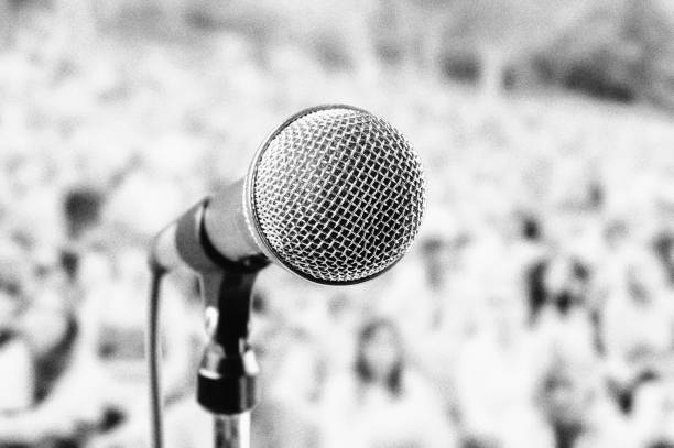 Microphone at outdoor music festival, with heavy film grain stock photo