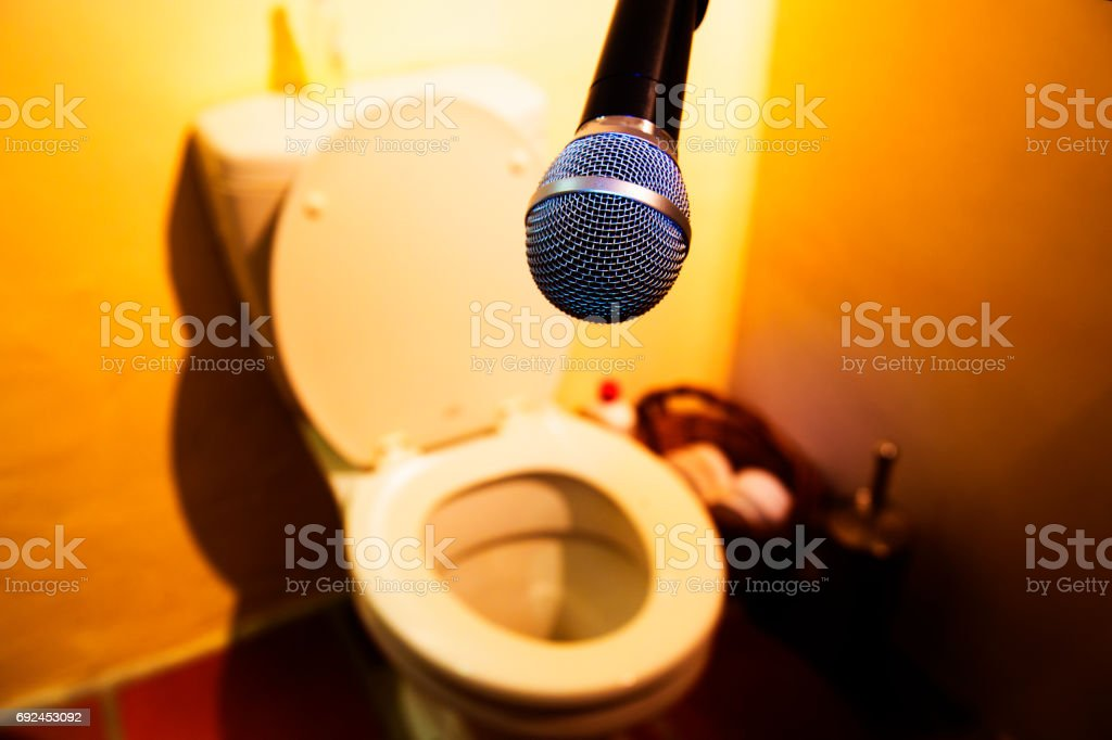 Microphone at the toilet in bathroom stock photo