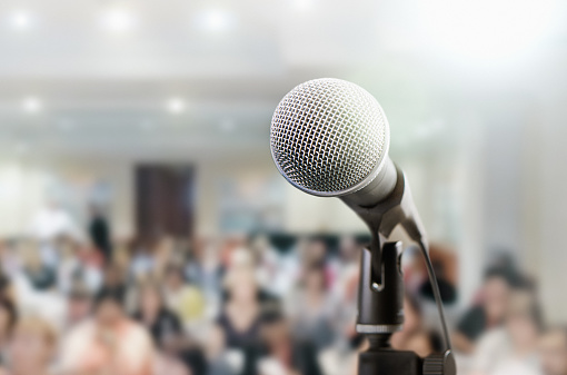 istock Microphone awaits public speaker at seminar 948890290