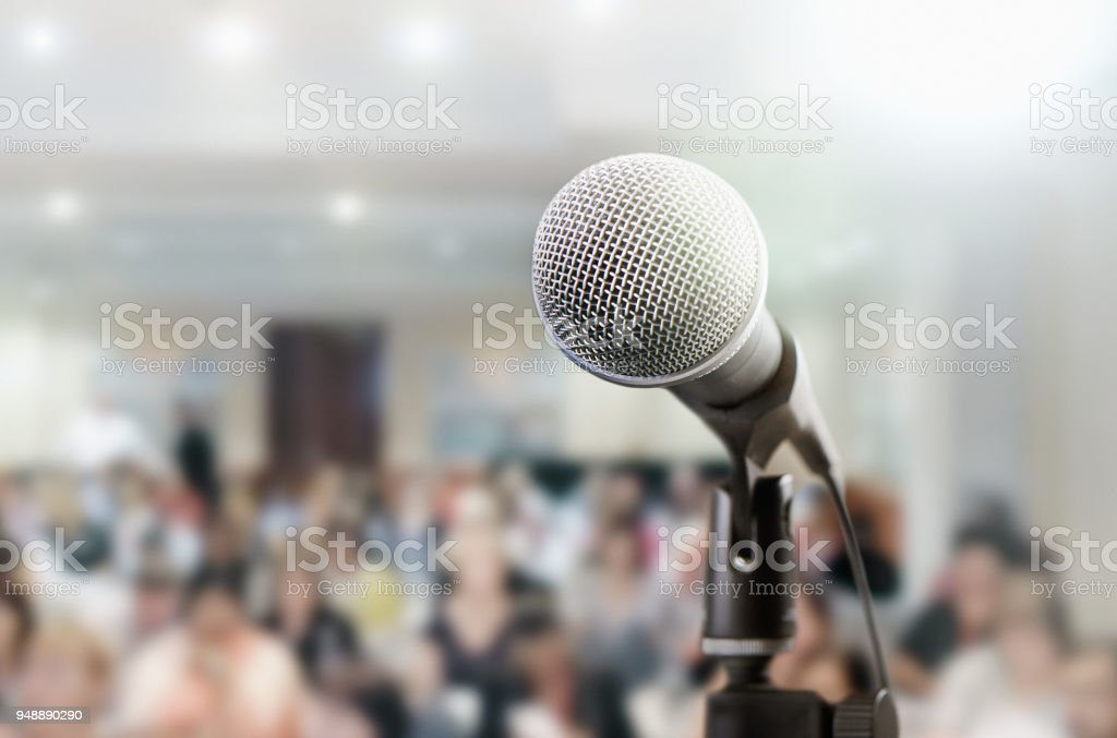 Microphone awaits public speaker at seminar stock photo