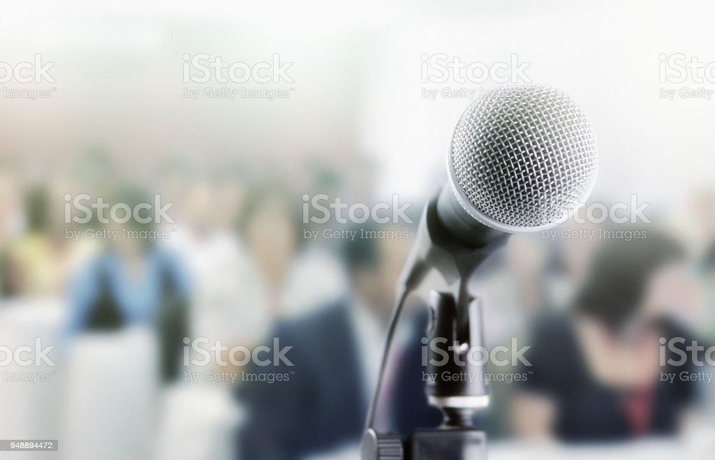Microphone awaits public speaker at seminar stock photo
