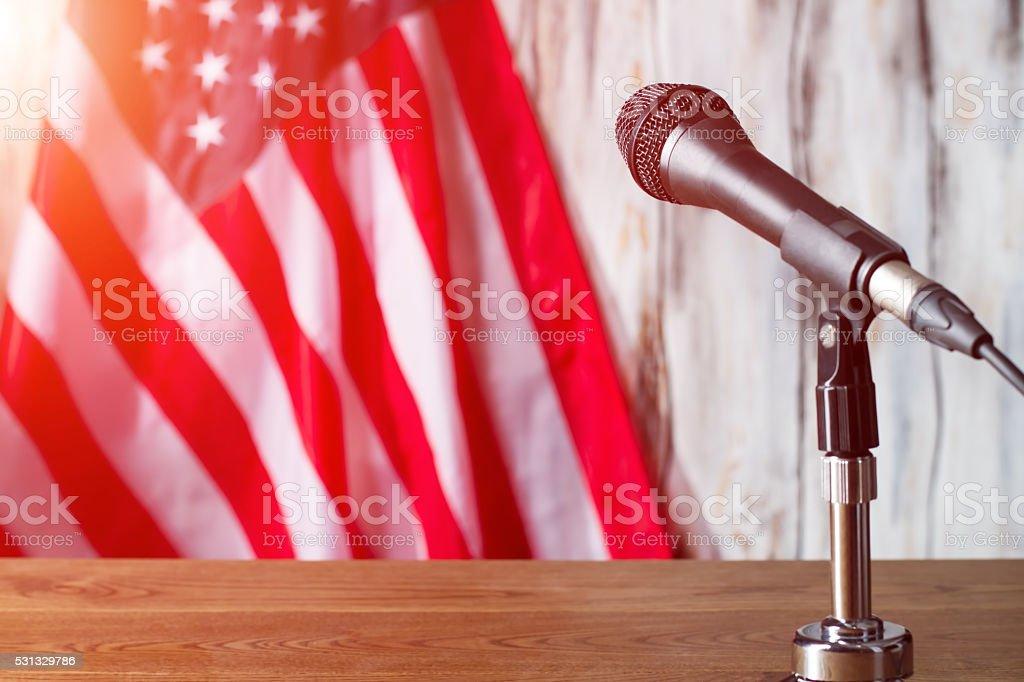 Microphone beside american flag. stock photo