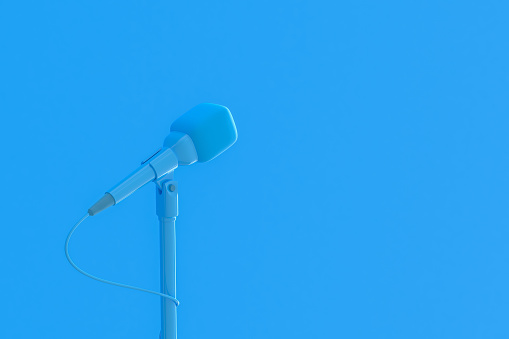 istock Microphone blue color music background 1157760551