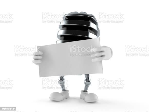 Microphone Character Holding Blank Sheet Of Paper — стоковые фотографии и другие картинки Аудиооборудование