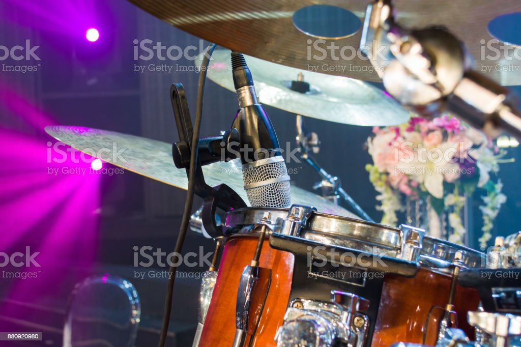 microphone for drum set up on show light background stock photo