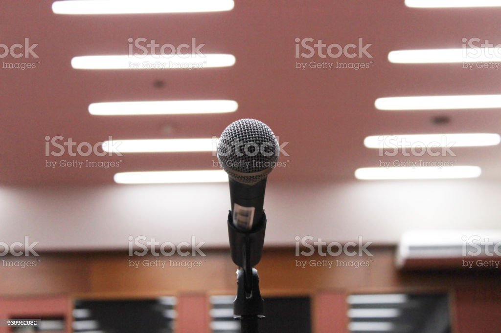 One microphone on a stand for public lectures in an auditorium
