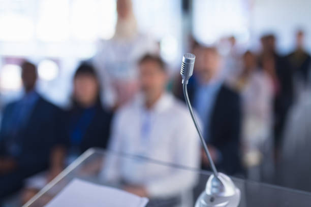 Microphone in business seminar at conference meeting stock photo