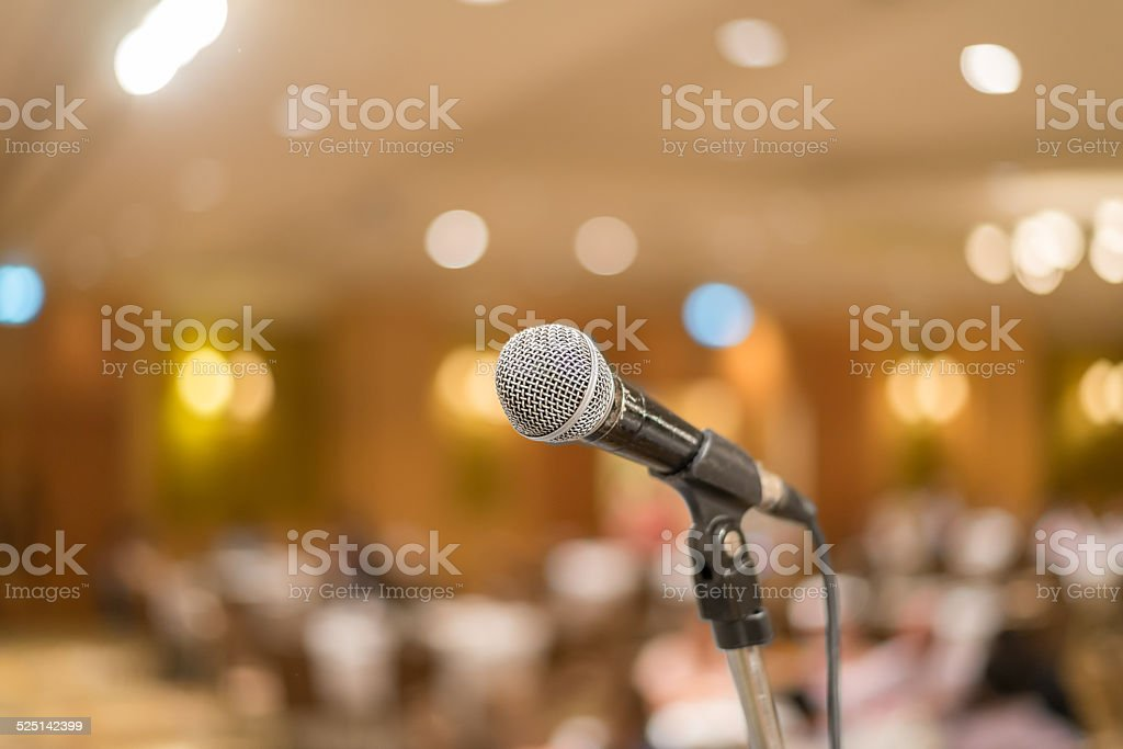 microphone in concert hall or conference room lights background stock photo