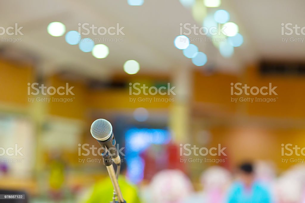 microphone in concert hall or conference room soft and blur style for background. stock photo