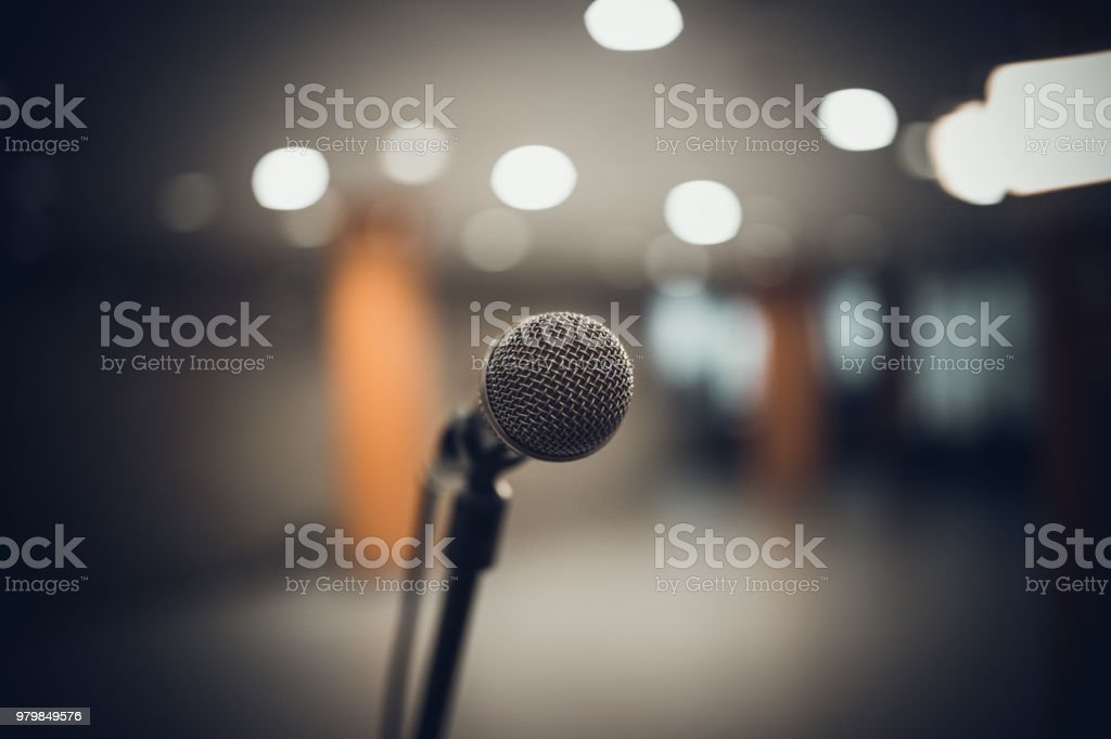 microphone in concert hall or conference room soft and blur style for background stock photo