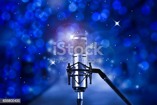 istock Microphone  in concert hall or karaoke stage 635800400