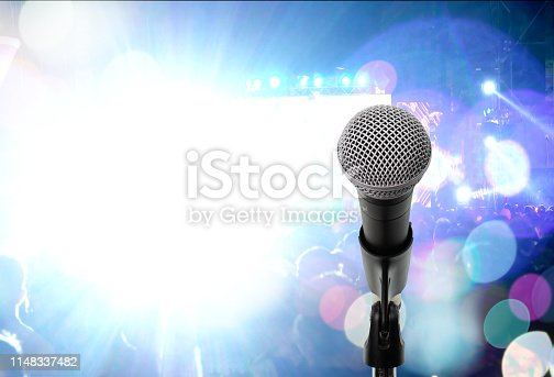 Close up dynamic microphone  on stage in music festival. Let's sing