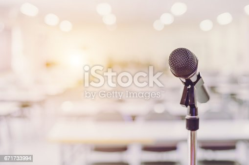 istock Microphone in Conference Seminar room Event Background 671733994