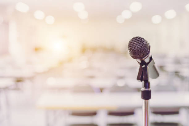 microphone in conference seminar room event background - press conference stock photos and pictures