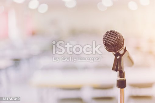671733994 istock photo Microphone in Conference Seminar room Event Background 671737340