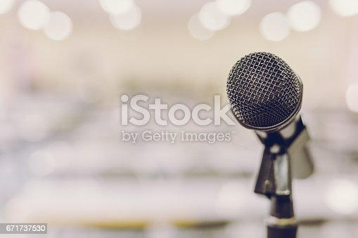 671733994 istock photo Microphone in Conference Seminar room Event Background 671737530