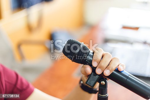 671733994 istock photo Microphone in Conference Seminar room Event Background 671738134