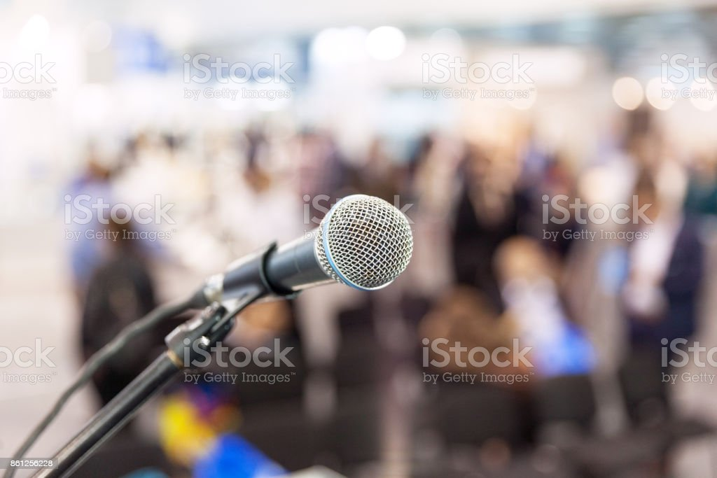 Microphone in focus against blurred audience. News conference. stock photo
