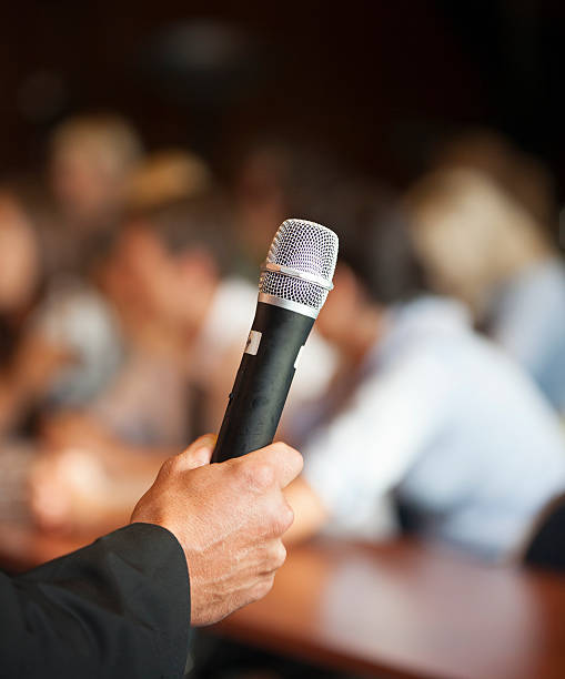 Microphone in front of an audience stock photo